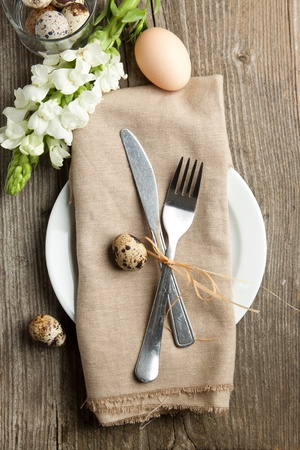 Easter table setting with flowers and eggs on old wooden table  Stock Photo - 12760509