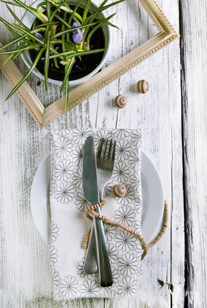 Rustic table setting on white wooden table with wooden decor and crocus flowers Stock Photo - 12760574