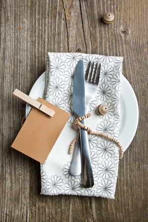 Rustic table setting on old wooden table with wooden decor Stock Photo - 12760594