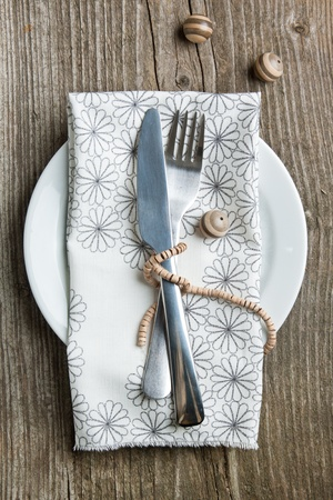 Rustic table setting on old wooden table with wooden decor Stock Photo - 12760654