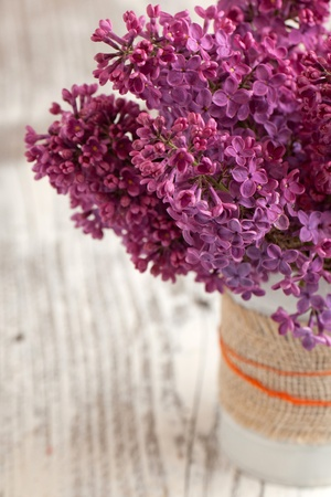 Bunch of lilac flowers on white wooden table Stock Photo - 13542098