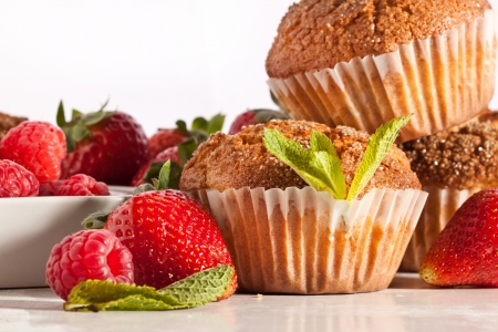 Colse-up of  muffins with fresh strawberries and raspberries on white table Stock Photo - 13736236