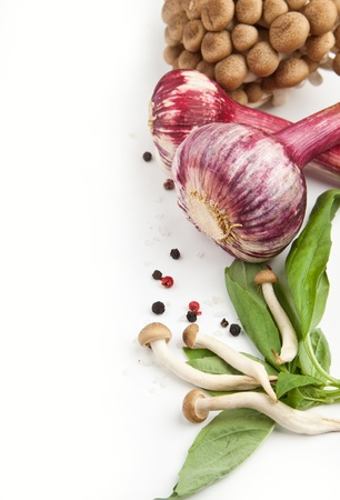 healthy living: Fresh mushrooms, garlic and basil over white