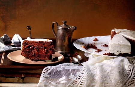 coffeepot: Chocolate cake on wooden table with old silver coffeepot