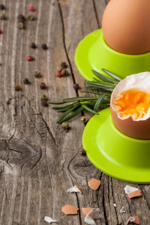 peeled boiled eggs in green cups with rosemary on wooden table Stock Photo - 18147411
