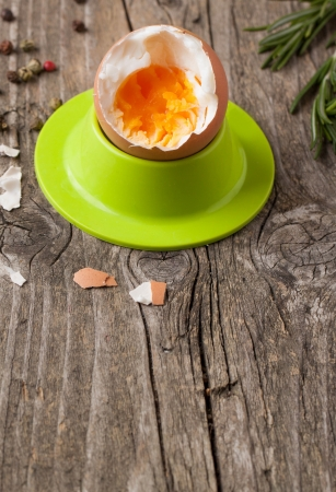peeled boiled egg in green cups with rosemary on wooden table Stock Photo - 18558553
