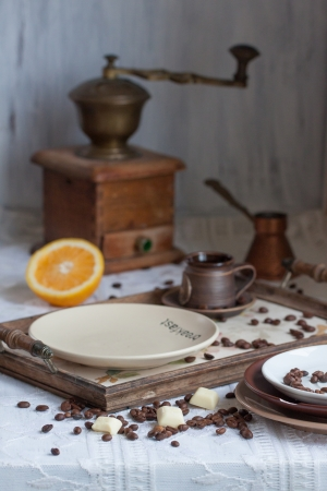 Ceramic plate with fresh orange and ceramic cup photo