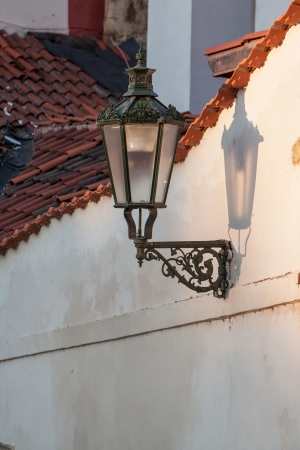 Old vintage lamp on wall in czech street  photo