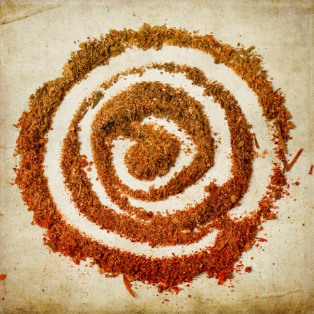 Top view on spiral of spices over textured background photo