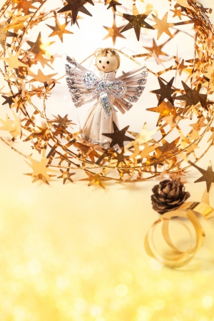 Christmas card with angel and golden stars with bokeh as background photo