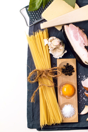 Top view on ingredients for pasta spaghetti alla carbonara over white photo