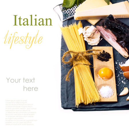 Ingredients for pasta spaghetti alla carbonara over white with sample text photo
