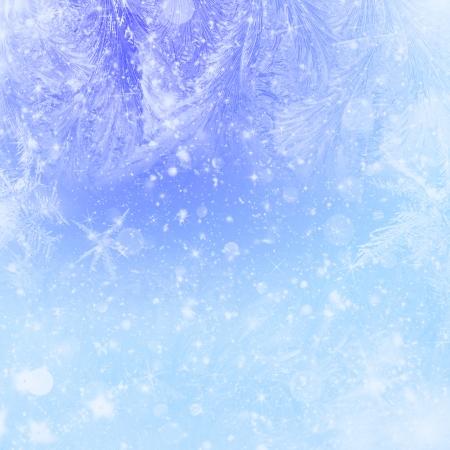 Sfondo Natale blu con stelle, gelo e bokeh Archivio Fotografico