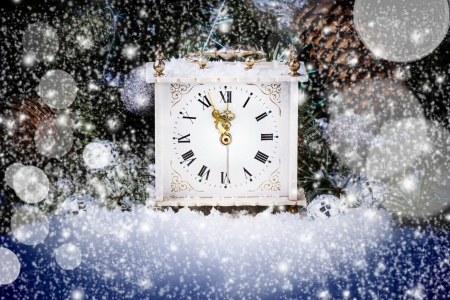 Vintage new year clock over christmas tree with blue bokeh  photo