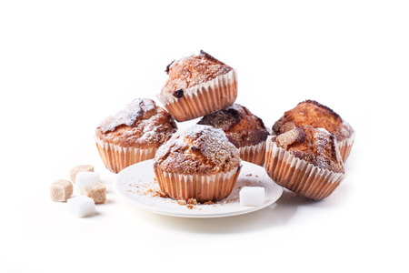 Homemade muffins with brown sugar isolated over white Stock Photo