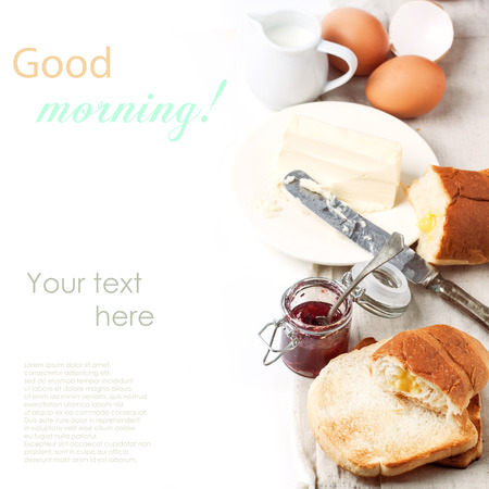 Breakfast with eggs and toasts served with jam and butter over white with sample text. See series. photo