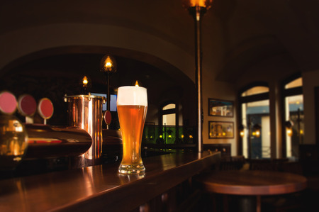Glass of lager beer on bar of restaurant Stock Photo