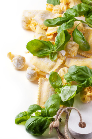 perle: Homemade pasta ravioli and perle with fresh basil over white