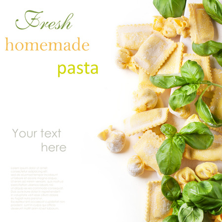 perle: Homemade pasta ravioli and perle with fresh basil over white with sample text Stock Photo