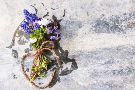 Bouquet of wildflowers over old metal background photo