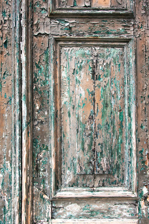 Fragment of old wooden door as background photo