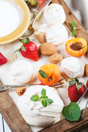 eton mess: Homemade meringue with apricots, strawberries, almonds and cream. Ingredients for dessert Eton mess. Stock Photo
