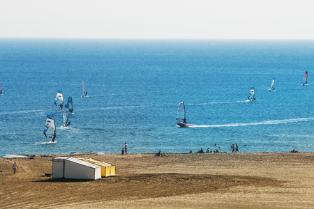 seaview: Seaview with sand beach and many surfers in sunny day, Rhodes, Greece Editorial