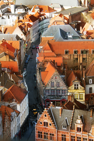 belfort: Birds-eye view from Belfort tower on facades and roofs of old medieval buildings Bruges, Belgium Stock Photo