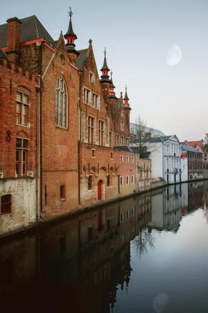 Facades of old medieval buildings in old town Bruges, Belgium photo