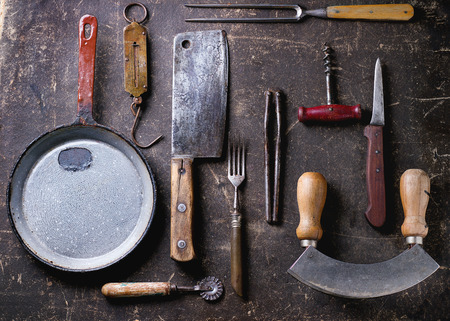cookware: Set of vintage cookware over dark background. Top view