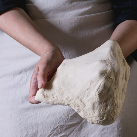 women's hands: Womens hands making the dough for pizza