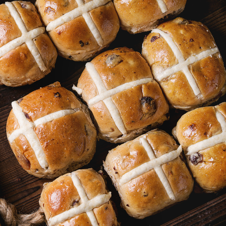 Hot cross buns in wooden tray. Close up. Top view. Easter baking. Square image
