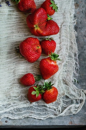 Fresh ripe organic strawberries prepared for making jam on gauze over gray metal background. Preserving concept. Top view. Rustic style, day light