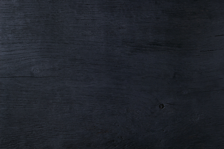 Black burned wooden abstract background copy space Standard-Bild