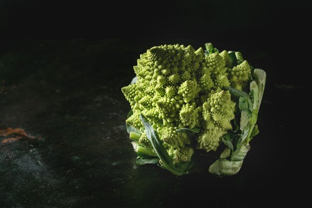 Fresh raw organic cabbage romanesco over dark texture background. Healthy eating concept Banco de Imagens - 88365272