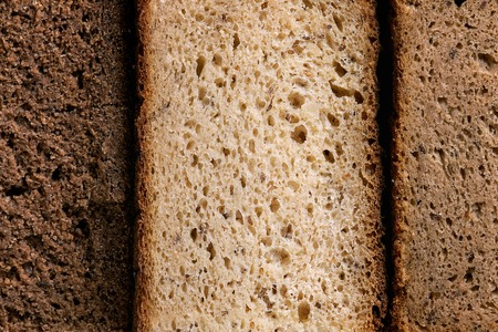 Variety loaves of sliced homemade rye bread whole grain. Top view, close up. Healthy eating food background