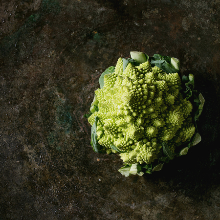 Fresh raw organic cabbage romanesco over dark texture background. Top view with space. Healthy eating concept. Square image Imagens