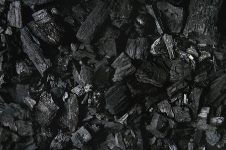 Black charcoal texture abstract surface background. Top view Stock Photo