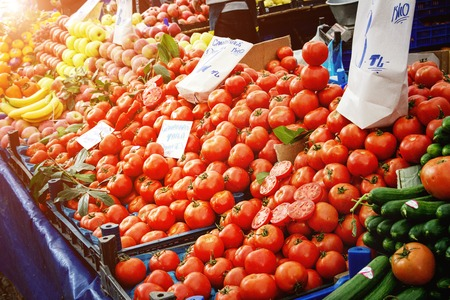 Turkish farmer market. Heap of fresh organic vegetables on the counter cucumbers, greens, tomatoes
