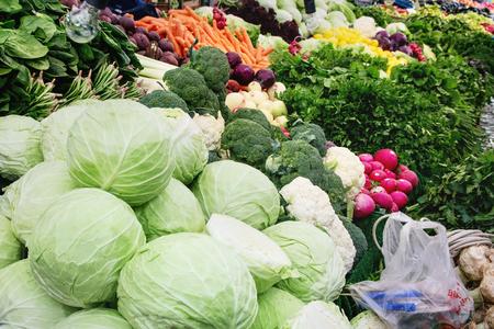 Turkish farmer market. Heap of fresh organic vegetables on the counter cabbage, cauliflower, greens, spinach, broccoli
