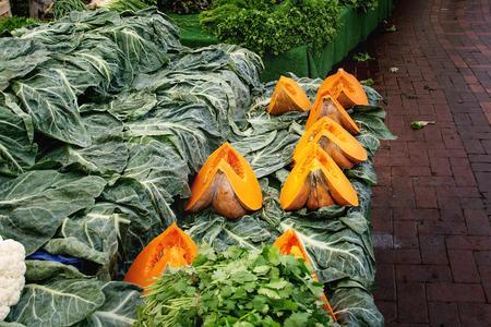 Turkish farmer market. Heap of fresh organic vegetables on the counter greens, spinach, sliced pumpkins