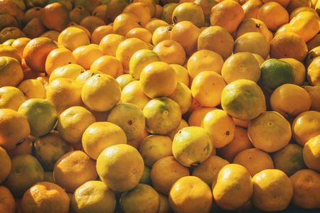 Turkish farmer market. Heap of fresh organic fruits on the counter oranges, tangerines