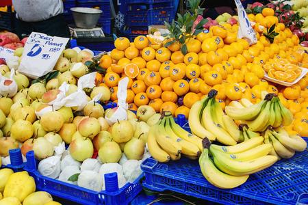 Turkish farmer market. Heap of fresh organic fruits on the counter oranges, apples, grapes, pomegranates, tangerines, bananas, persimmons