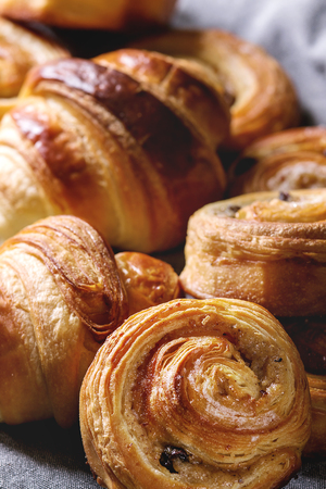 Variety of homemade puff pastry buns cinnamon rolls and croissant. Close up. Stock Photo