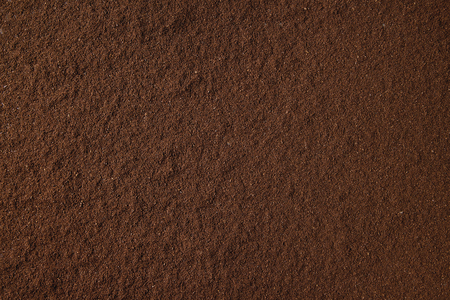Ground black coffee food abstract background.