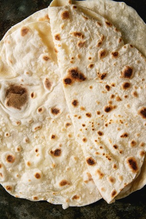 Homemade pita or chapati flatbread flapjack over dark metal background. Flat lay, close up Stock Photo - 119352226