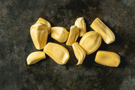 Ripe raw peeled jackfruit over dark metal background. Flat lay, space Stock fotó
