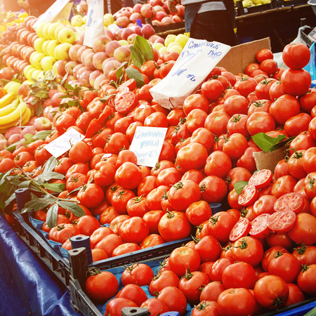 Turkish farmer market. Heap of fresh organic vegetables on the counter cucumbers, greens, tomatoes. Square image