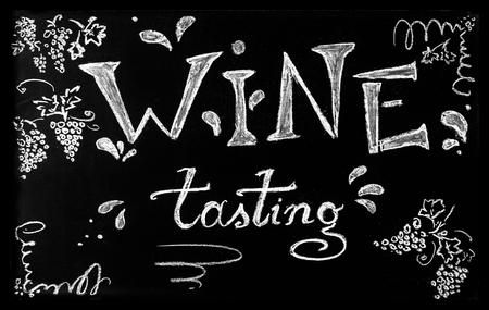 Wine tasting concept. Chalkboard with handwritten chalk lettering Wine tasting. Imagens