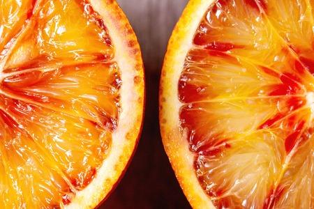 Close up macro of fresh organic Sicilian blood oranges sliced.